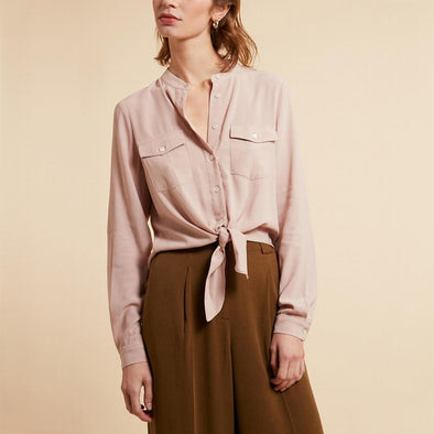 Soft pink shirt with two front pockets.