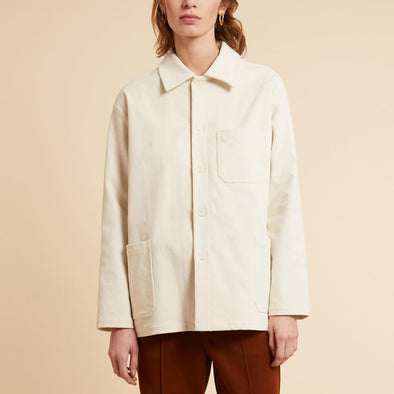 Ecru long sleeved overshirt with three front pockets.