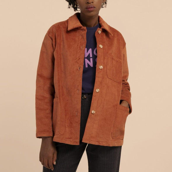Terracotta long sleeved overshirt with three front pockets.