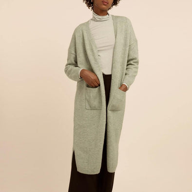 Mint green long cardigan featuring low shoulders and two front pockets.