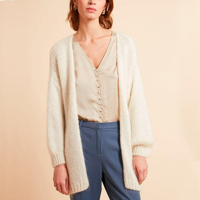 White large mesh cardigan featuring drop-down sleeves.
