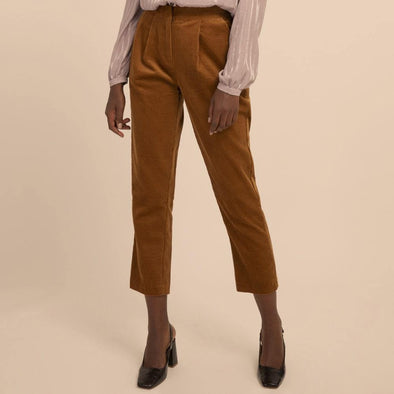 Straight cut ochre corduroy trousers with side pockets.