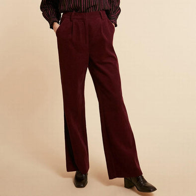 Retro wide fit burgundy pants with flared hems.