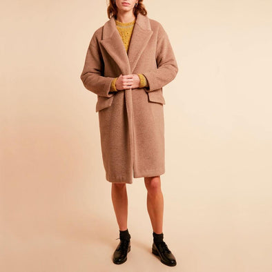 Beige soft long coat with patch pockets.