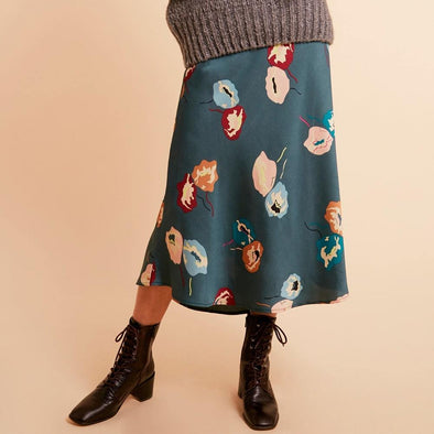 Blue fluid midi skirt with a flower pattern.