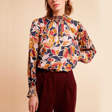 Delicate patterned top with high collar and ruffled sleeves.