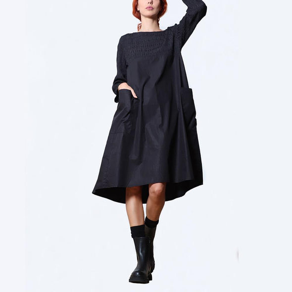 A-line black dress with ¾ sleeves and upper part of the dress and sleeves are made of a smocking fabric and skirt in cotton poplin.