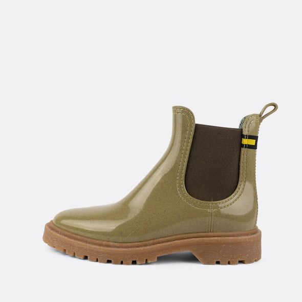 Green chelsea rain boots made from recycled materials.