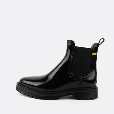 Black chelsea rain boots made from recycled materials.