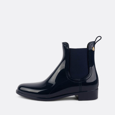 Glossy navy blue chelsea rain boots in non-toxic PVC.