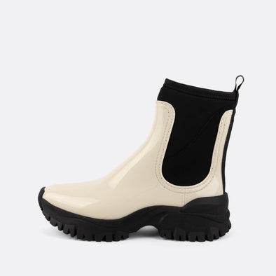 Black and white vegan chelsea rain boots in non-toxic PVC.