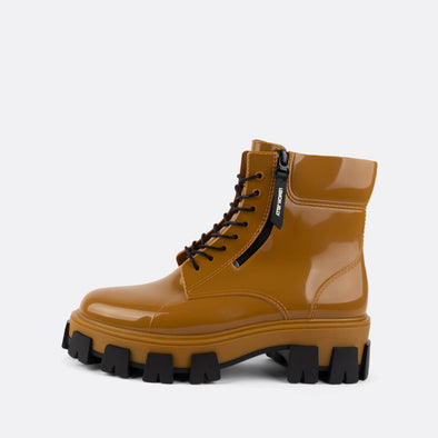 Rusted gold vegan lace-up rain boots in non-toxic PVC.