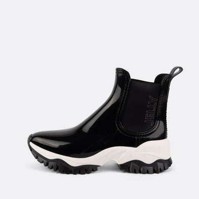 Vegan black rain boots with a white sporty outsole.