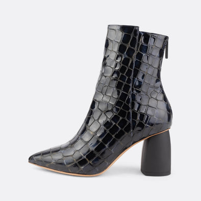 Heeled ankle boots in deep blue croc embossed leather.
