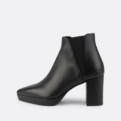 Black nappa boots featuring elastics, a pointed toe and squared heel.