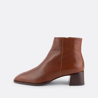 Brown nappa short heeled booties with round square toe.