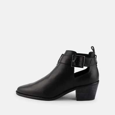 Black nappa short heeled booties with laterals openings and buckle fastening.