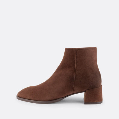 Brown suede short heeled booties with round square toe.