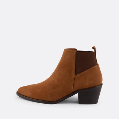 Camel suede heeled booties with pointed toe and cuban heel.