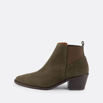 Green suede heeled booties with pointed toe and cuban heel.