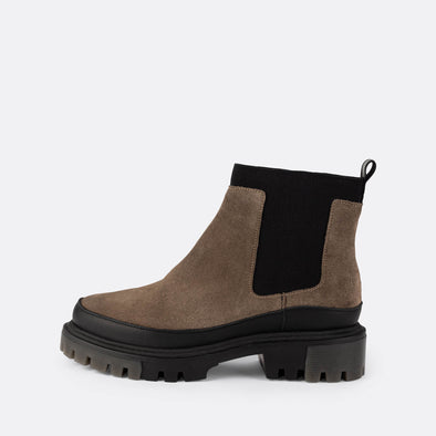Grey suede chelsea boots with chunky black sole.