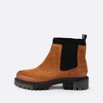 Brown suede chelsea boots with chunky black sole.