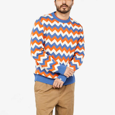 Straight cut sweater with tricolor irregular striped pattern.
