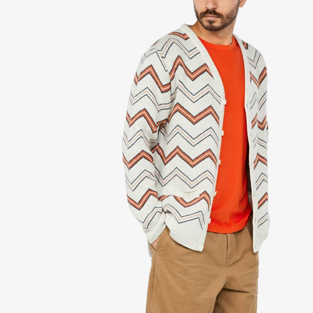 Straight cut wool cardigan featuring a V-neck and a tricolor striped pattern.