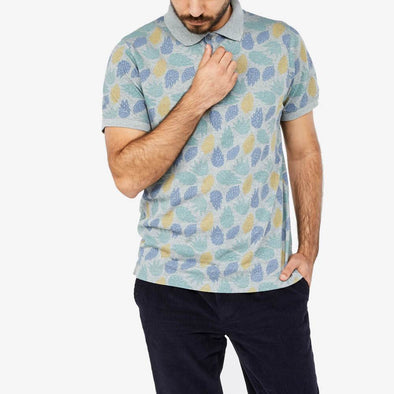 Short sleeved polo shirt with multicolored leaves all-over-print.