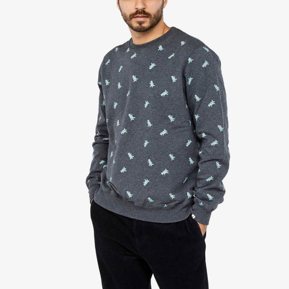 Black sweatshirt with dinosaur all-over print and elastic ribbing.