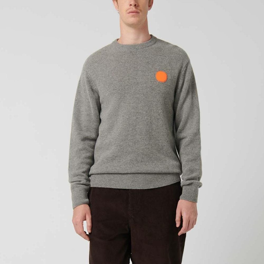 Grey regular fit knit sweater with a rubber patch detail on chest.