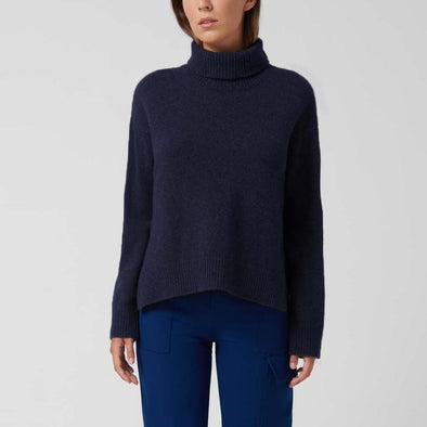 Navy blue chunky knit sweater with a roll neck.