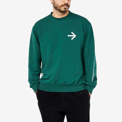 Green sweatshirt with an arrow on the chest and text on the bottom right and left sleeves.