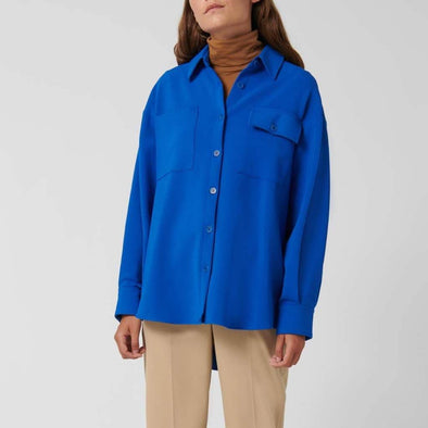 Blue shirt with collar and long sleeves finished with buttoned cuff and fastening with buttons.
