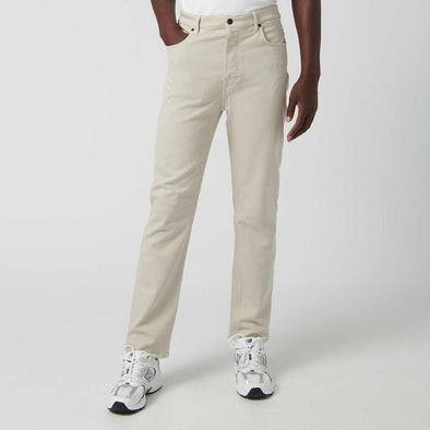 Relaxed fit beige denim trousers with five pockets.