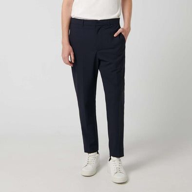 Navy regular tapered fit wool chino trousers cropped with waistband side pockets and back double welt pocket.