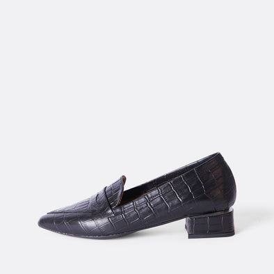 Ballerina black leather loafers with crocodile engraved texture and detail on the heel.