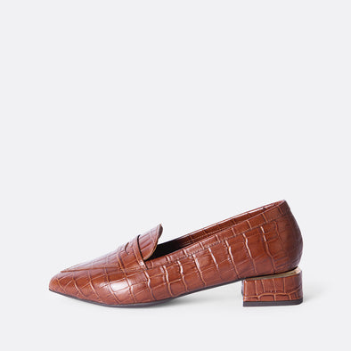 Brown leather smart loafers with crocodile engraved texture and detail on the heel.