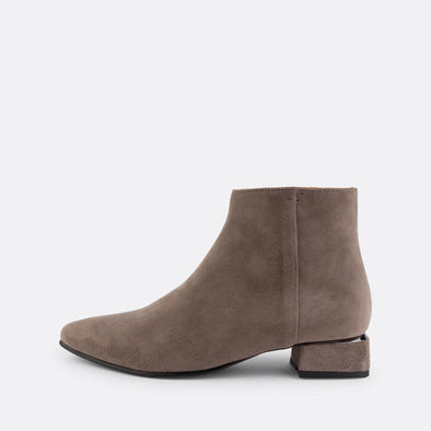Grey suede ankle boot with detail on the heel and side fastening.