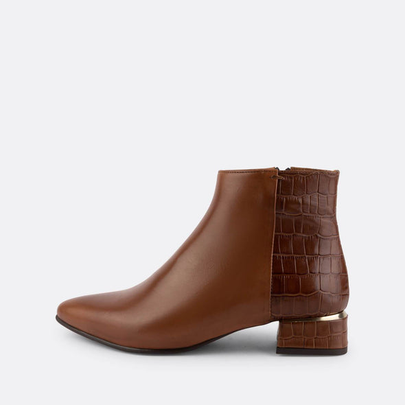 Brown leather ankle boot featuring crocodile engraved texture with detail on the heel and side fastening.