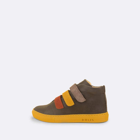 Kids' mid-top sneaker in grey leather with yellow rubber sole and three multi-color velcro straps.