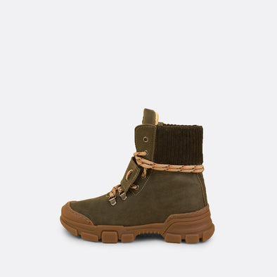 Kids' green leather chunky boots with brown rubber track sole and mountain laces.