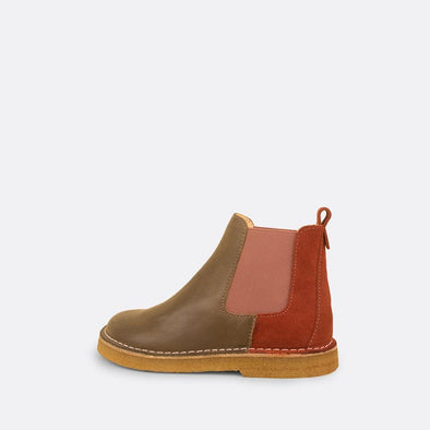 Kids' multi-color chelsea boots with pink elastic and natural rubber sole.