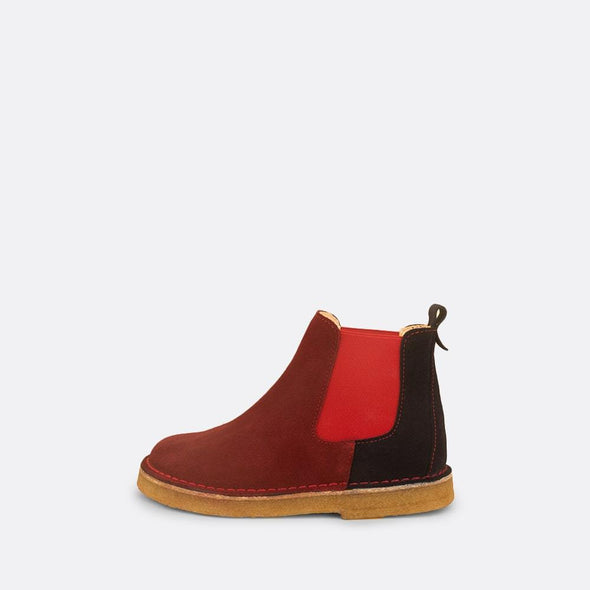 Kids' multi-color chelsea boots with red elastic and natural rubber sole.