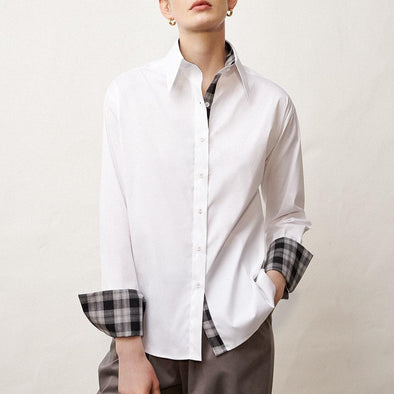 Essential white shirt with plaid collar and cuffs.