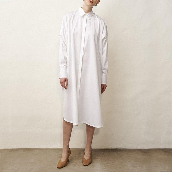Minimalist midi shirt dress in white with long sleeves.