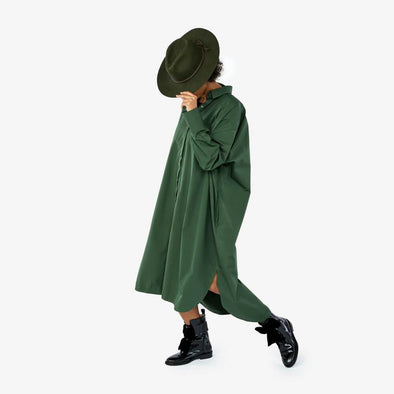 Oversized forest green midi shirt dress featuring a belt to tie at the waist.
