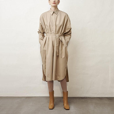 Minimalist midi shirt dress in beige with long sleeves and waist tie.