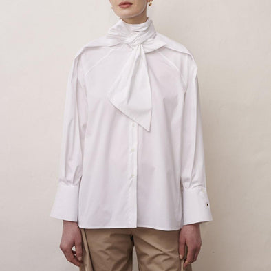 Minimalist white blouse with neck tie.