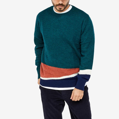 Multicolored pattern knit that runs through the left cuff.